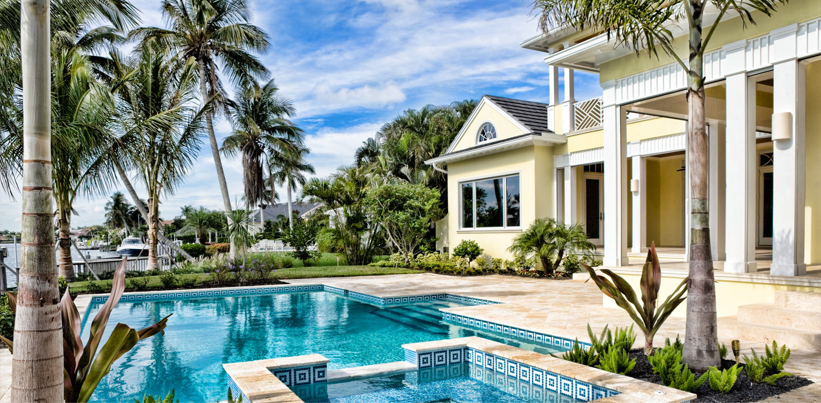 A luxury home with swimming pool and coconut trees